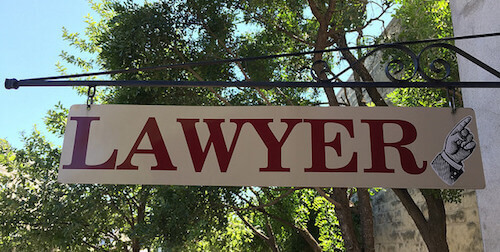sign saying lawyer with finger pointing